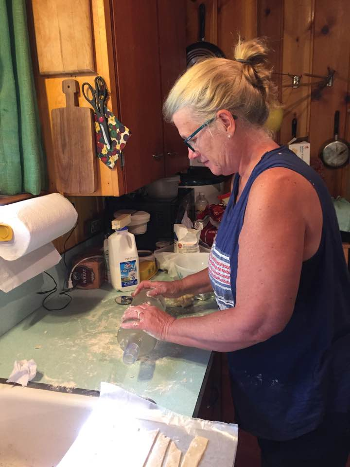 My ma making homemade chicken & dumplings.  She couldn't find a rolling pin so she made do with a vodka bottle!