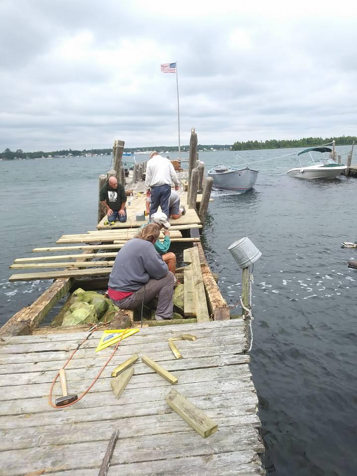 Working hard to repair 30 feet of dock.