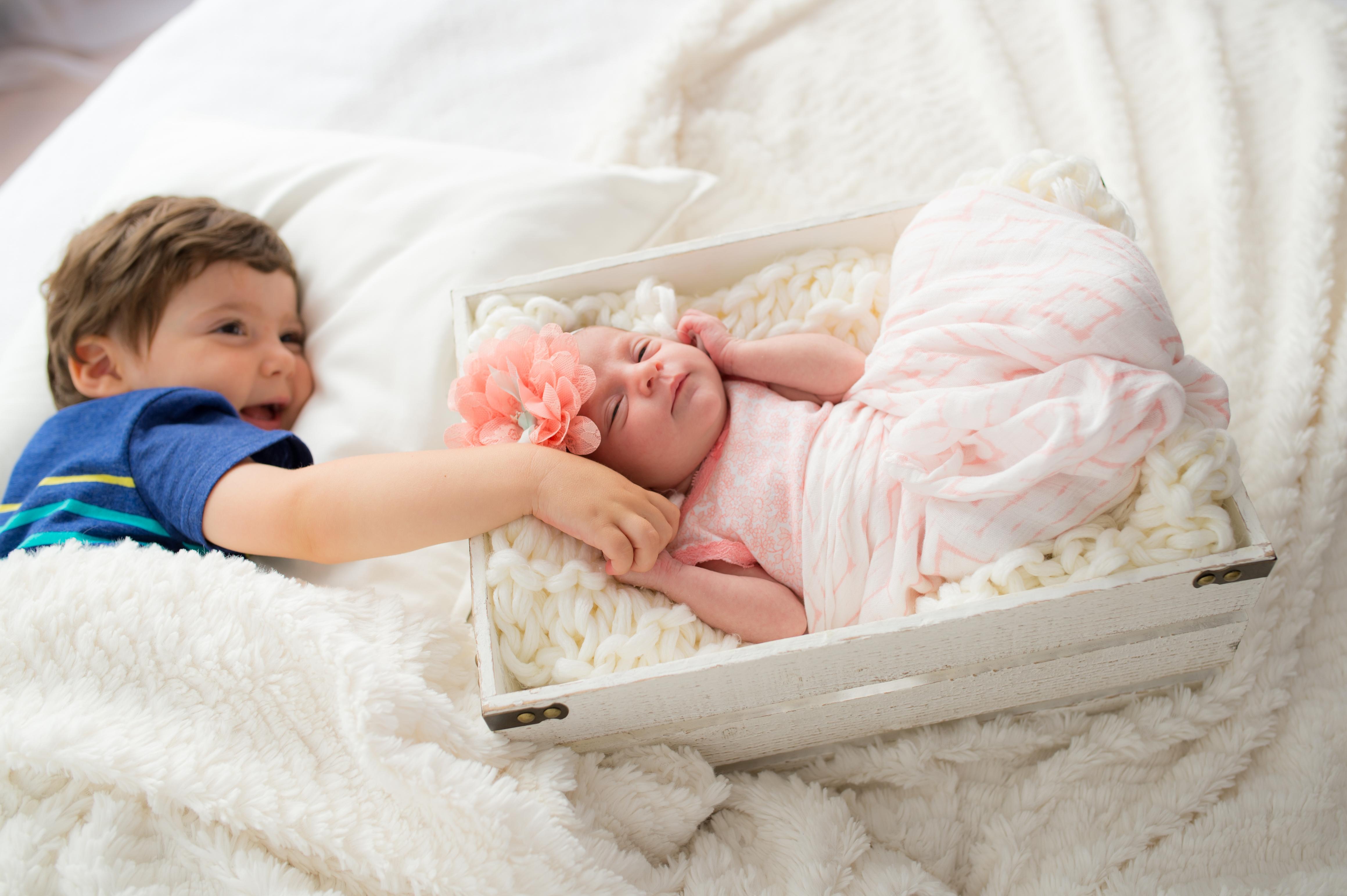newborn girl brother