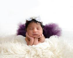 newborn girl pose