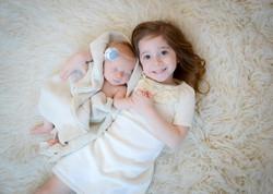 newborn girl sisters