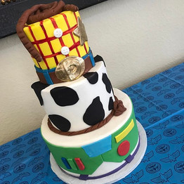 They had a Mickey Mouse wedding cake, Minnie Mouse for Addison's baby shower and her first birthday...jpg