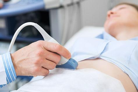 Sonographer using ultrasound machine at