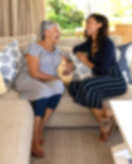 two-women-talking-in-the-sofa-at-home-PF