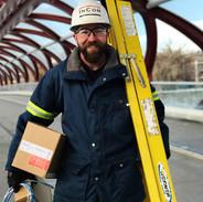 Ed Holding Ladder.jpg