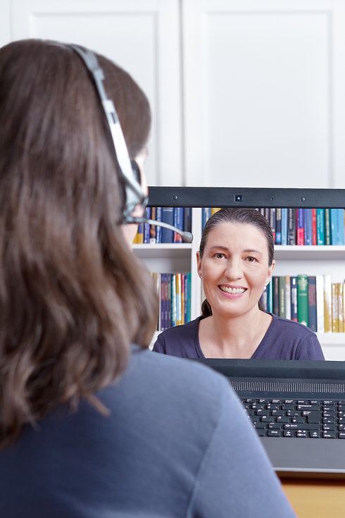 Woman with headset at her desk in front