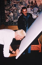 Jean-Paul Gaultier signs his shadow (painting) by klaus guingand in 1990.