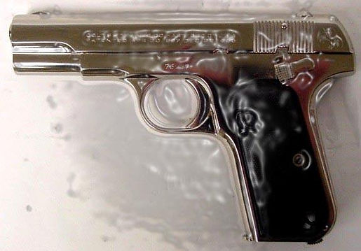 "Klaus Guingand artwork : "" Colt 38 in ice "" : Real Colt 38 in the ice.Ephemeral artwork : 1992"