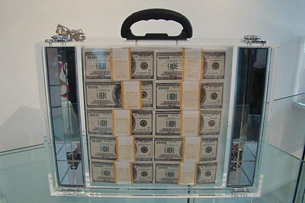 In God we trust, plexiglass briefcase artwork. One $ million cash in plexiglas briefcase: 18,50 in x 5,90 in x 13,78 in. 13 Kg. Klaus Guingand