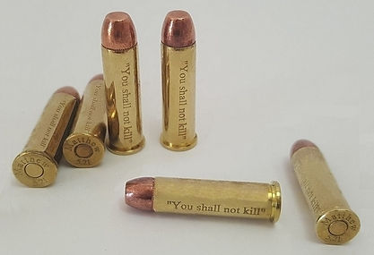 "​klaus Guingand artwork: Six .357 Magnum bullets engraved ""You shall not kill"" and  ""Matthew 5.21"" ​ ​"
