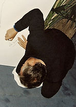 Peter Gabriel signs his shadow (painting) by klaus Guingand in 1995