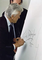 Kirk Douglas signs her shadow (painting) - 1995