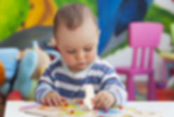 Baby boy and jigsaw puzzle