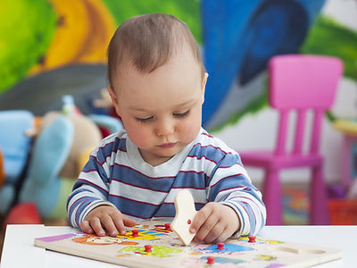 Baby with jigsaw puzzle