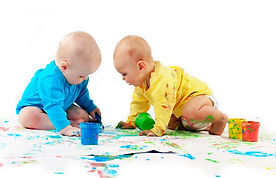 Babies play with paint
