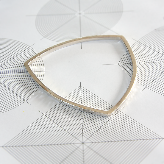 Curved triangular bangle