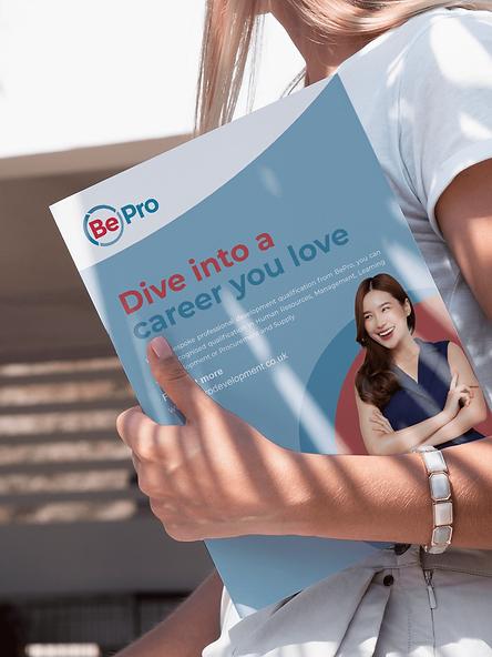 Brochure-in-hand.png