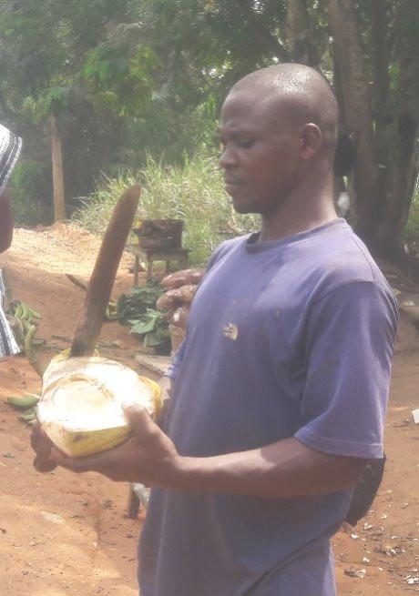 machete man with coconut