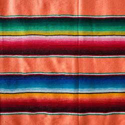 Orange themed, striped Mexican woollen blanket