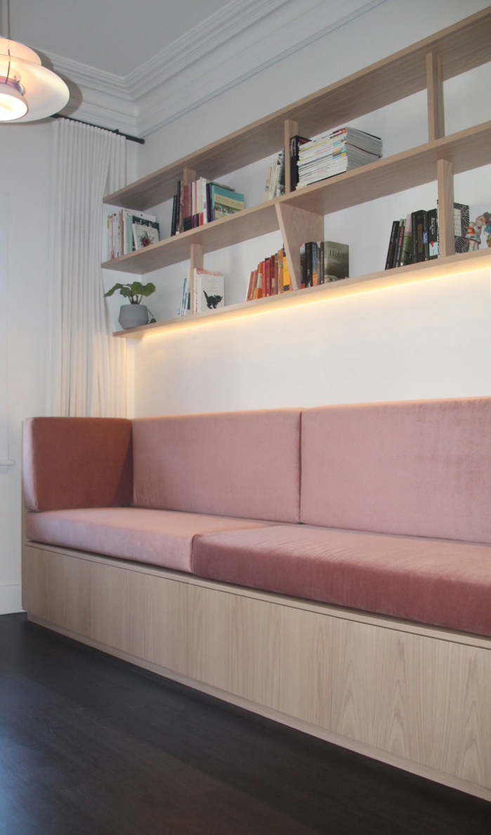 Built in sofa with velvet cushions, custom shelves and storage