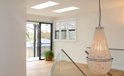 Thornleigh stair chandelier lounge