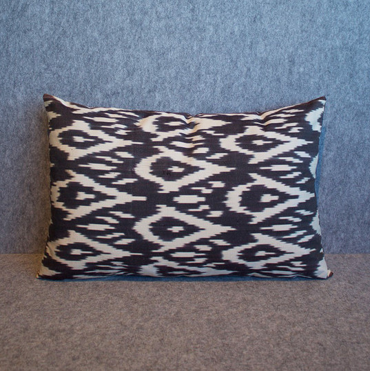 Single sided, black + cream silk ikat cushion cover