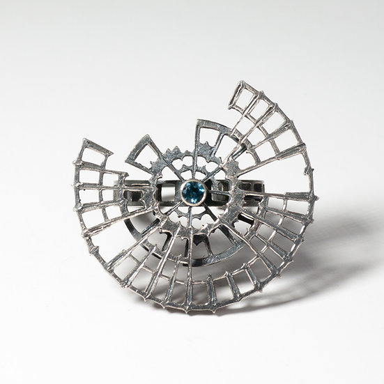 London Blue Topaz kinetic orbital ring, geometric Hand engraved saw pierced Tom Asquith Jewellery patina oxidised
