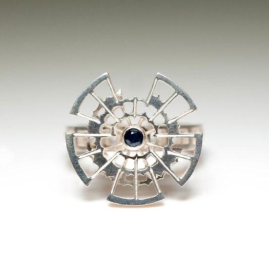 Black Sapphire kinetic orbital ring, geometric Hand engraved saw pierced Tom Asquith Jewellery patina oxidised