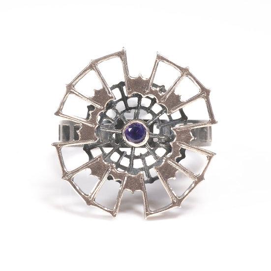 Amethyst kinetic orbital ring, geometric Hand engraved saw pierced Tom Asquith Jewellery patina oxidised