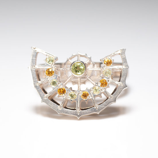 Citrine peridot kinetic orbital ring, geometric Hand engraved saw pierced Tom Asquith Jewellery front veiw