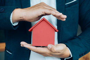 business-man-hand-hold-the-house-model-s