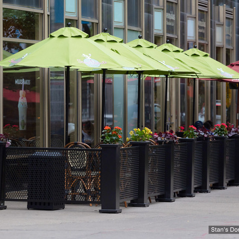 SelectSpace sidewalk partitions, planters and umbrellas at Stan's Donuts