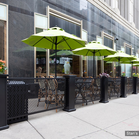 SelectSpace patio fencing, planters and umbrellas at Stan's Donuts