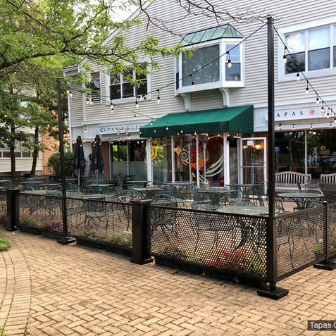 Outside seating fence by SelectSpace with custom string light poles and planter boxes for outside dining, patios, and crowd control.  By SelectSpace Partitions.