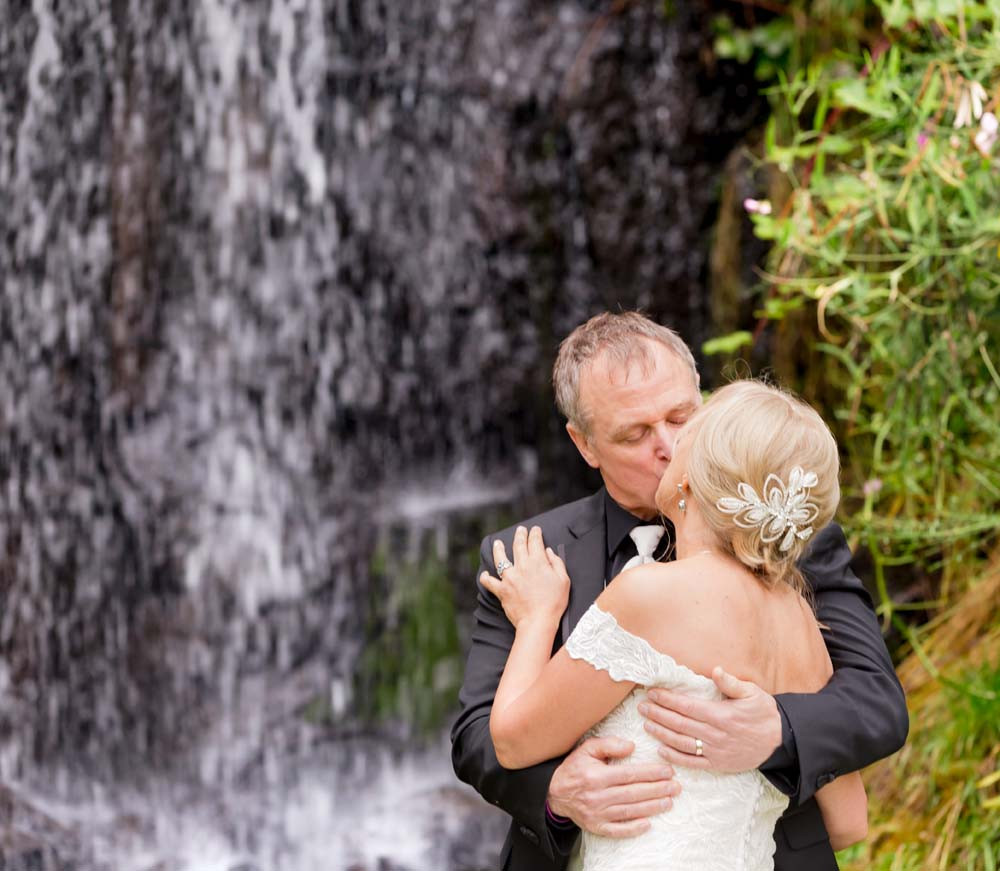 Kiss by the waterfall
