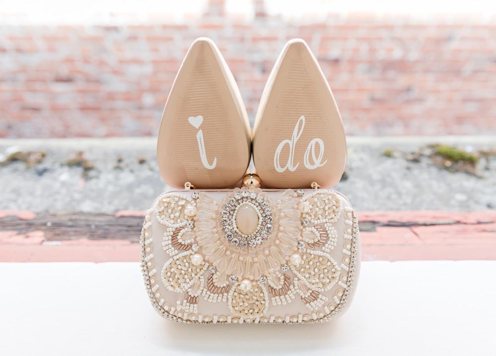 """I do"" on bottom of shoes"