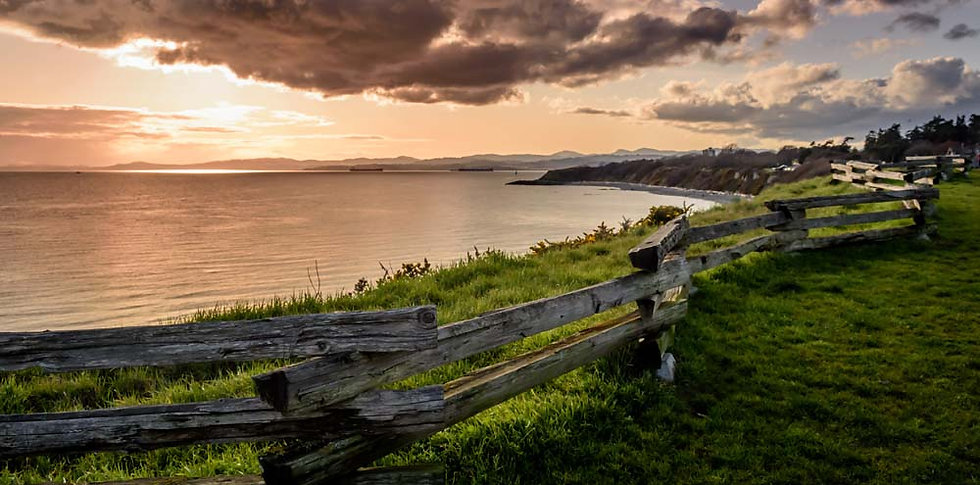 Wooden fence along seaside cliff on Dallas Road in Victoria BC