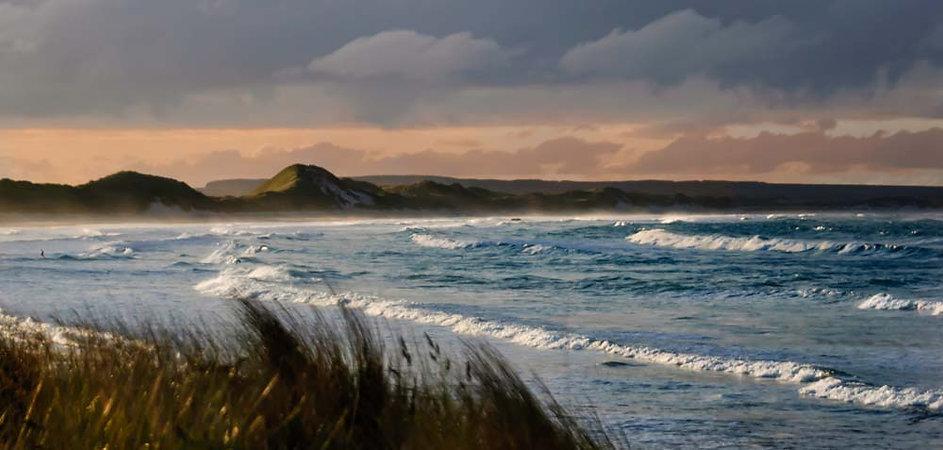 Ocean waves roll into the Bay near Wich, Scotland