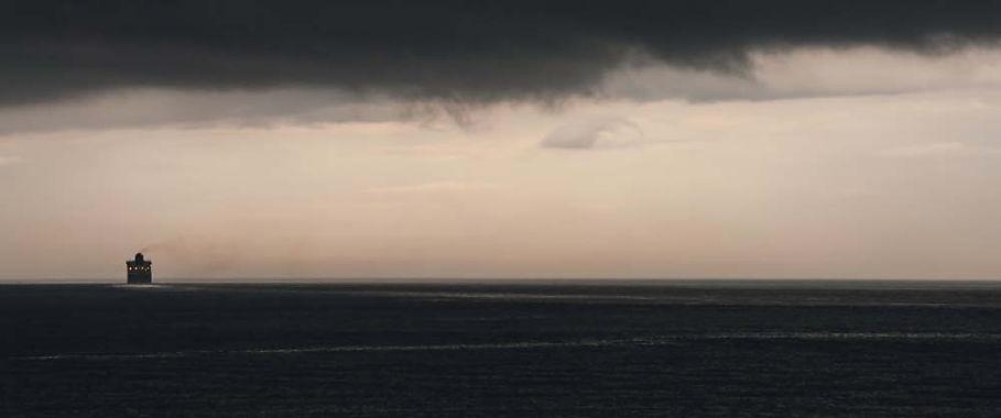 Ship on ominously calm sea near Belfast