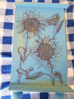 Sunflowers on cupboard
