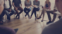People sitting in a circle counseling.jp