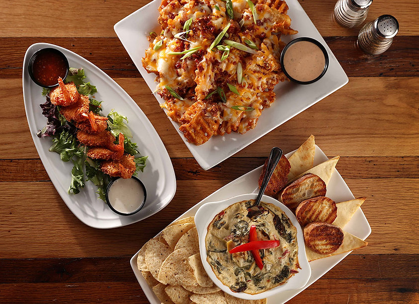 Three plates of S&P appetizers