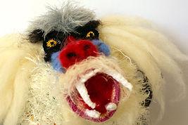 creative crochet sculpture, contemprary textile sculpture, textile baboon