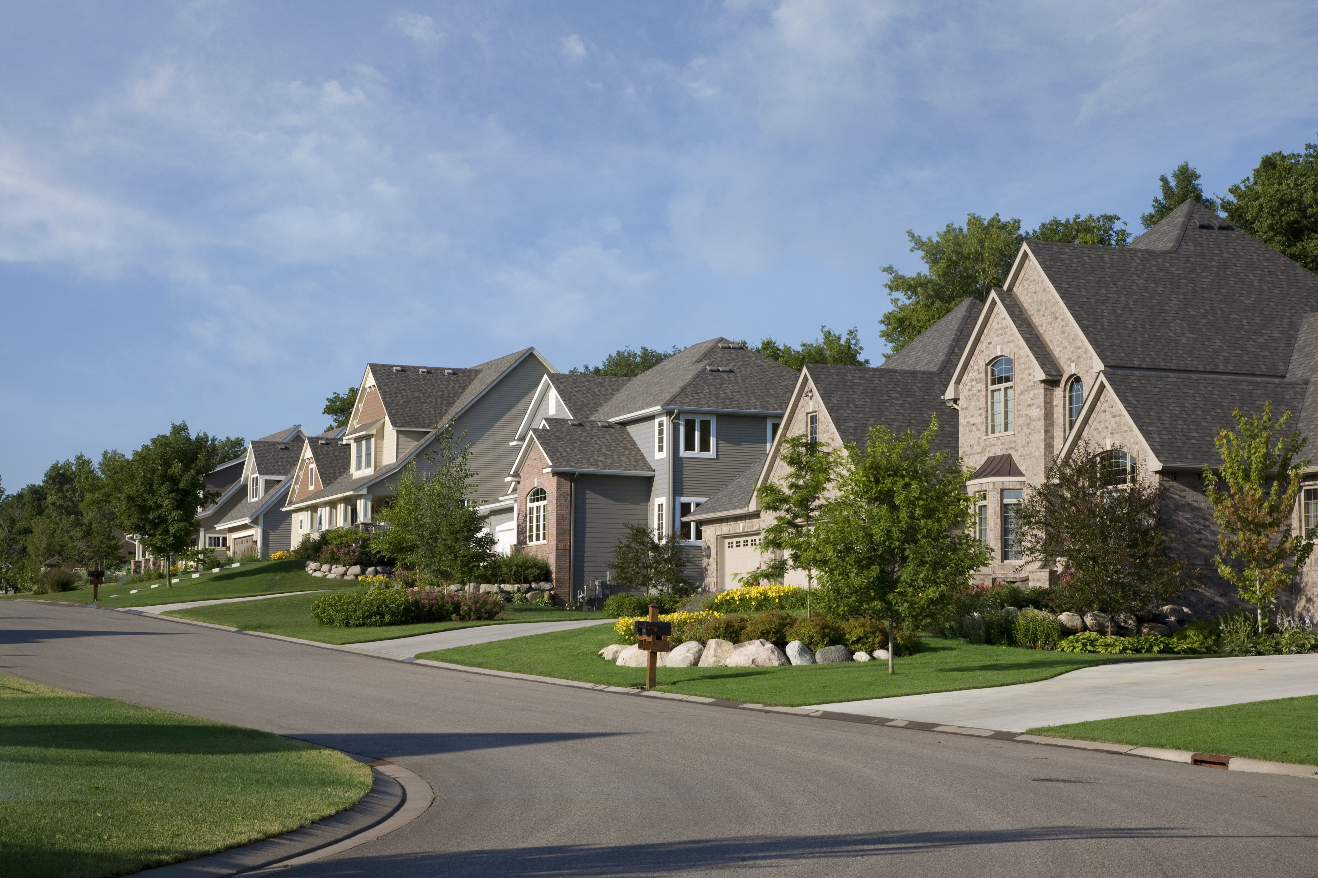 Upscale houses on a suburban street in t