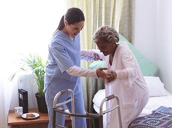 nurse-helping-home-care-patient_edited.j