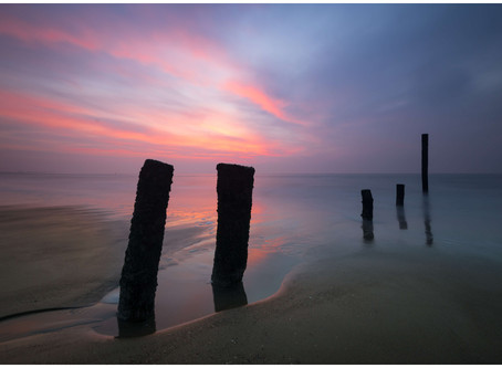 Long exposure shot of sea break piles at the beach of Cadzand.