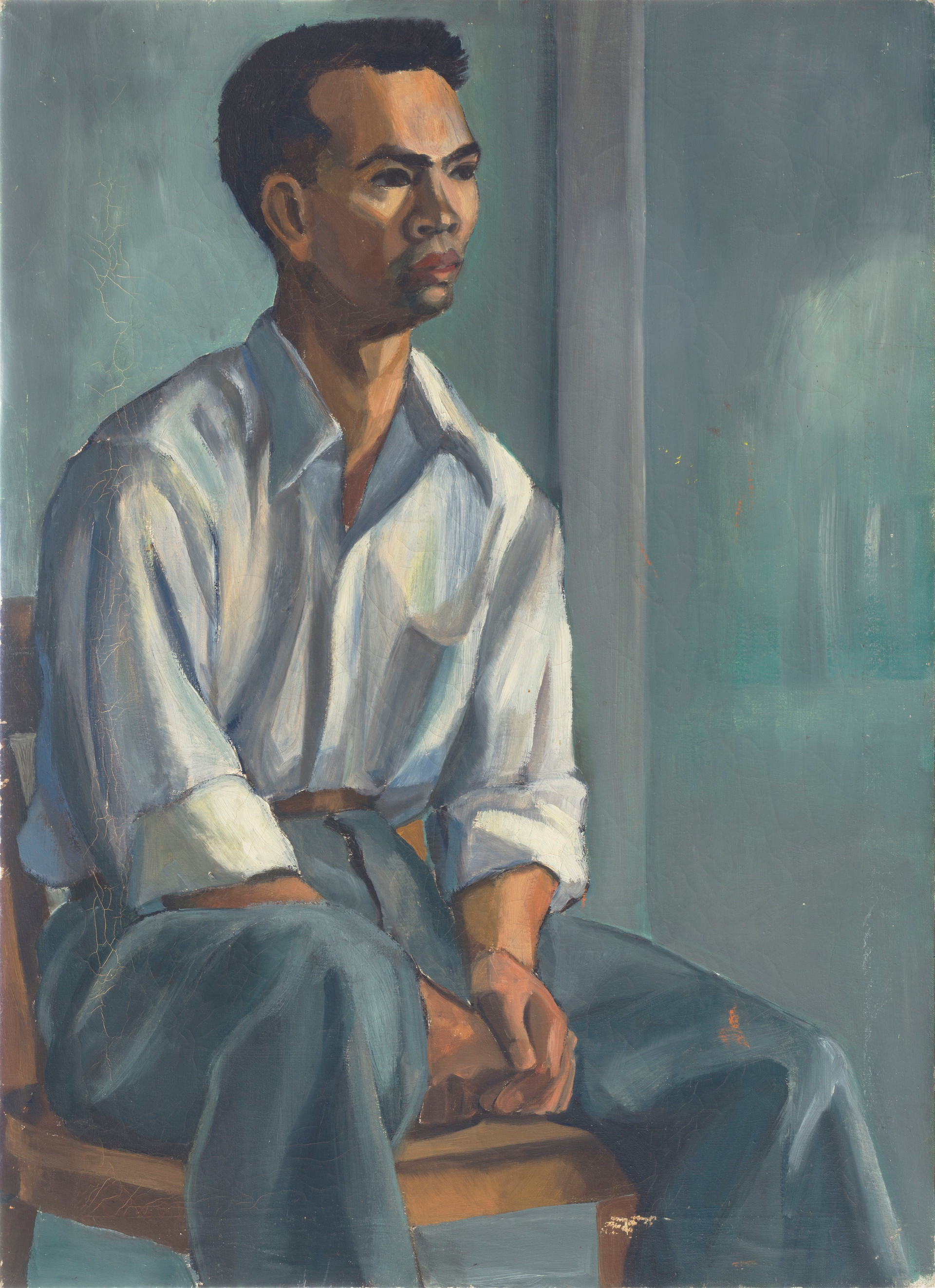 Untitled - portrait of art student sitting on chair in blue room
