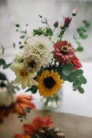 Zinnias, sunflowers, eucalyptus