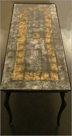 tavolo in ferro e vetro stratificato in foglia oro e argento