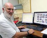 Romsey History Society member Malcolm Heathcote recording photographs to data base